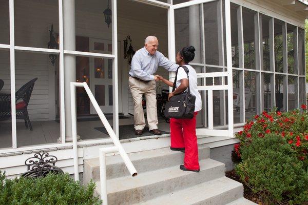 home healthcare worker visits elderly man