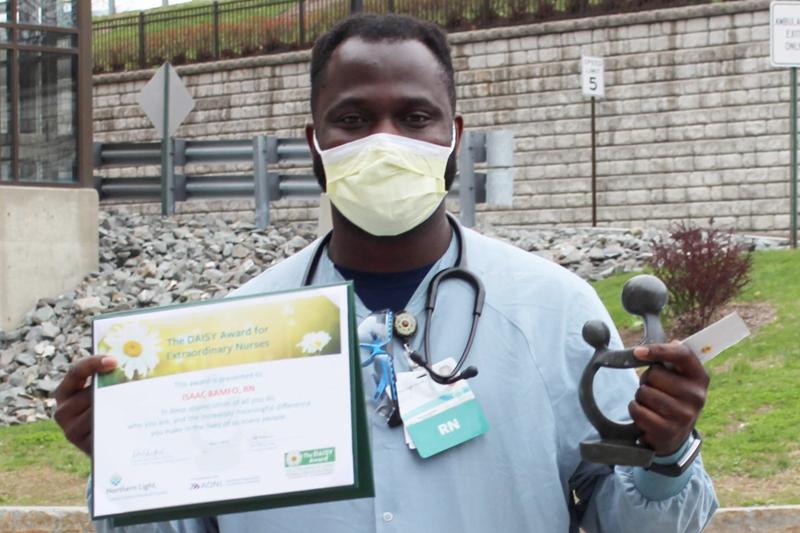 male nurse holding certificate