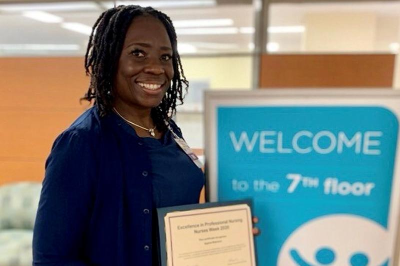 female nurse holding certificate