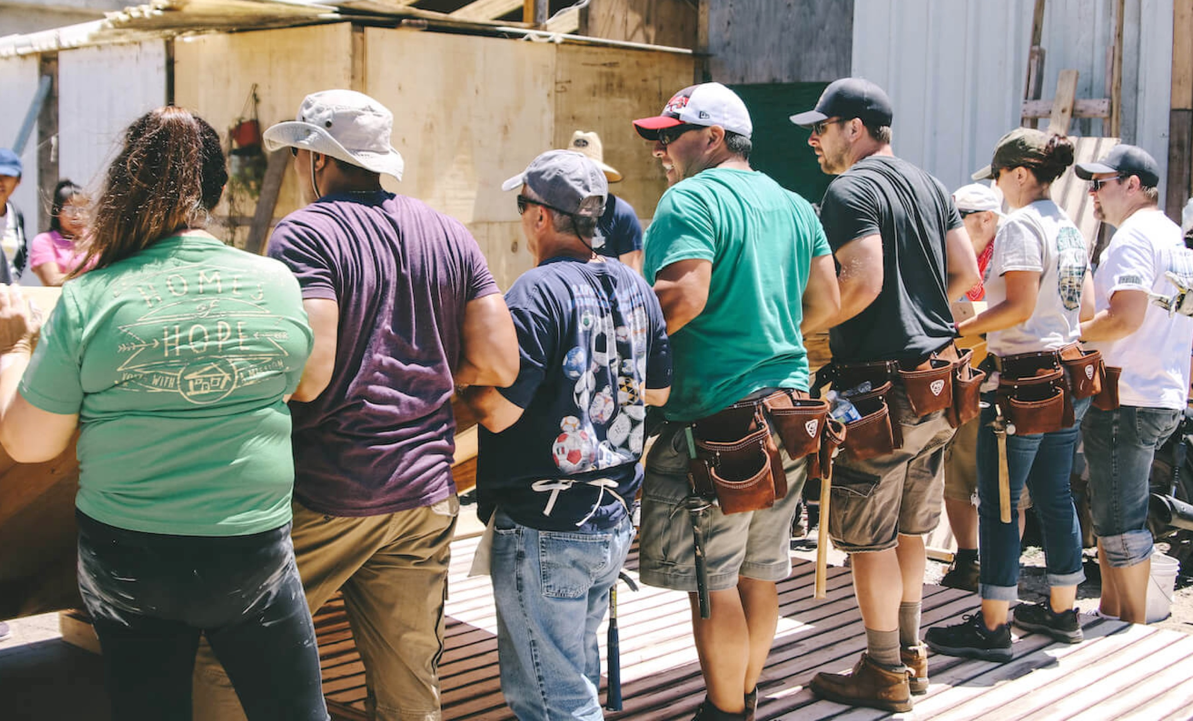 group of volunteers building at construction site