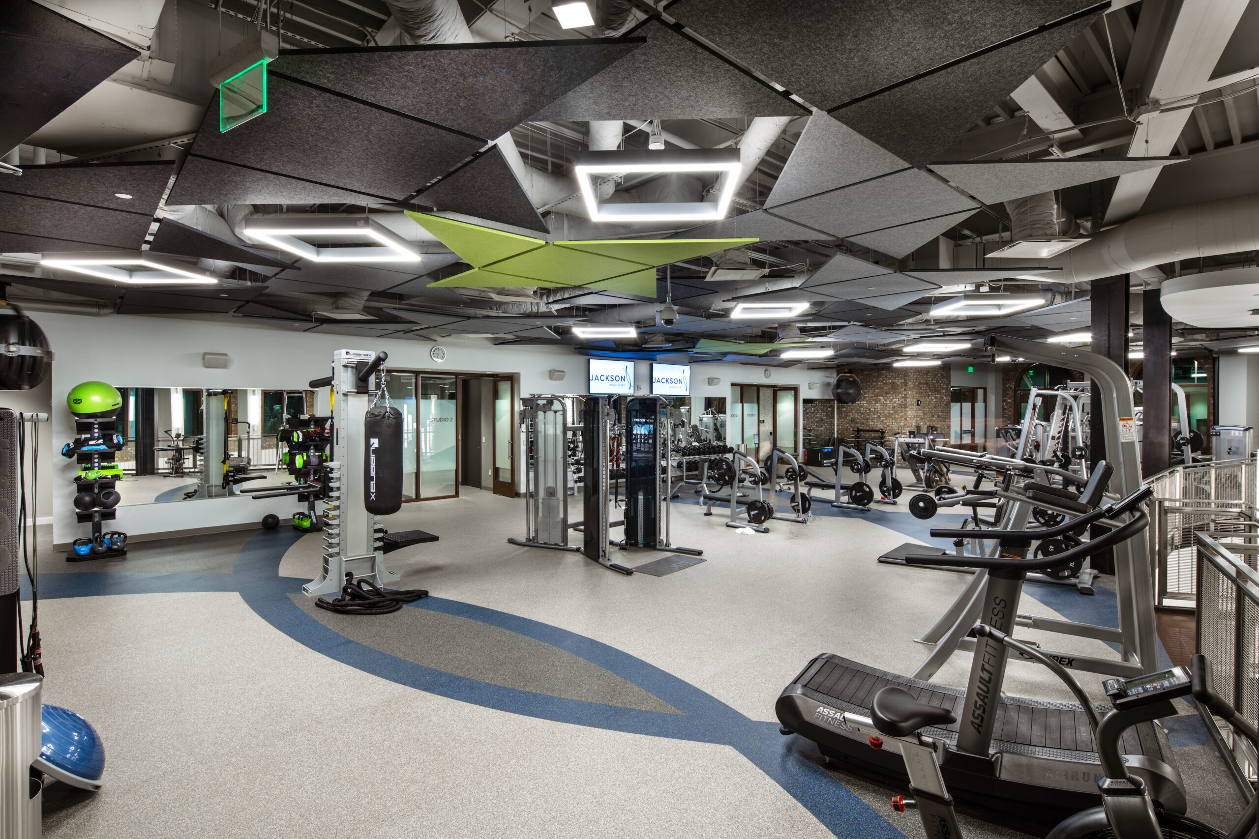 fitness facility with weights and cardio equipment