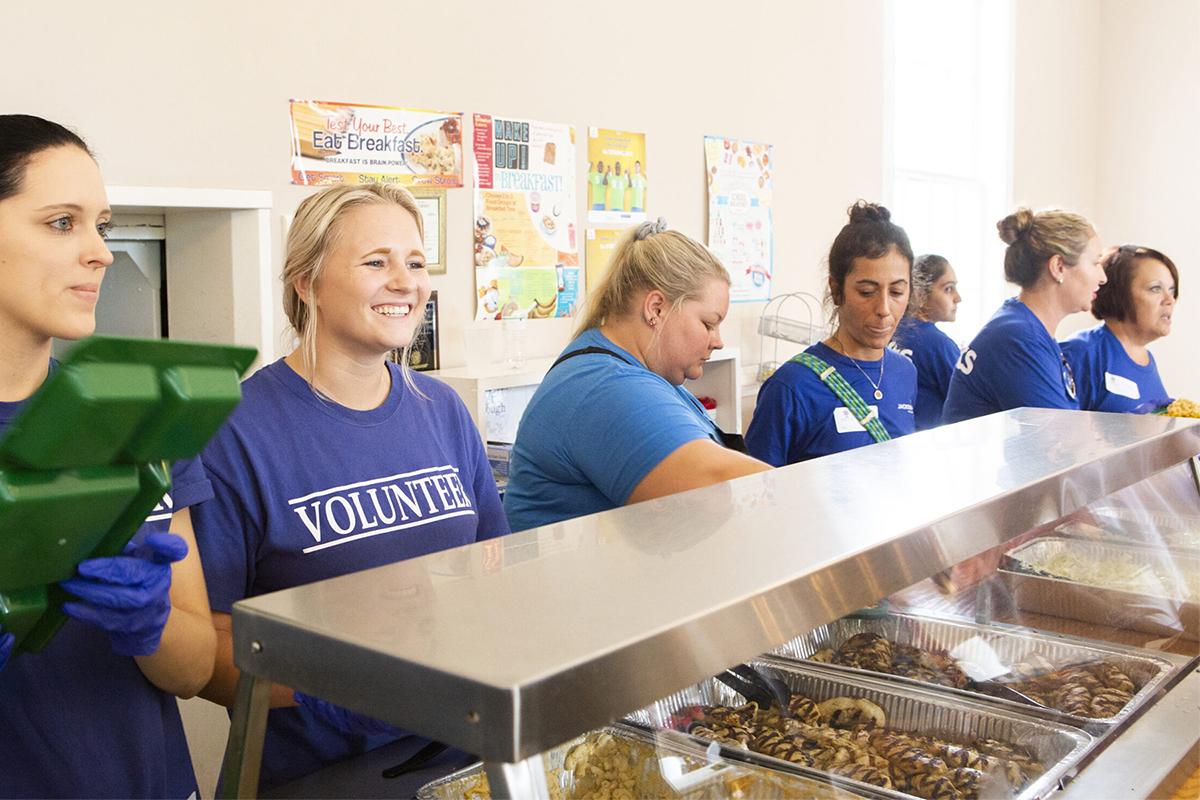 group of volunteers serving food